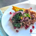 Roasted Winter Squash with Pearl Barley and Pomegranate on a white plate