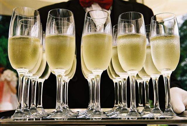 tray with many glasses of chilled Champagne