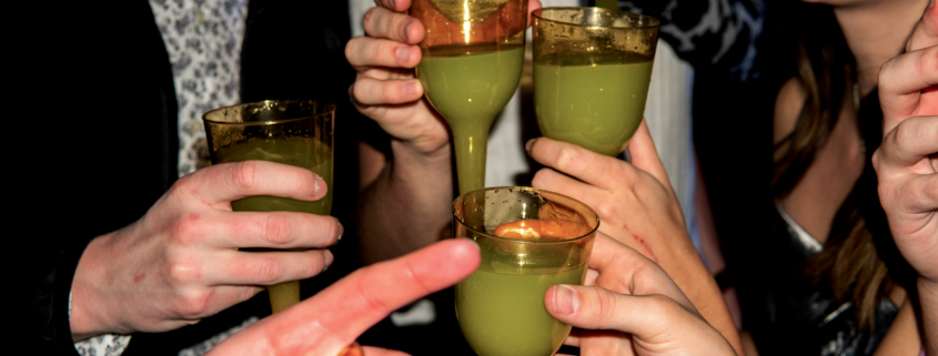 group enjoying absinthe at a party