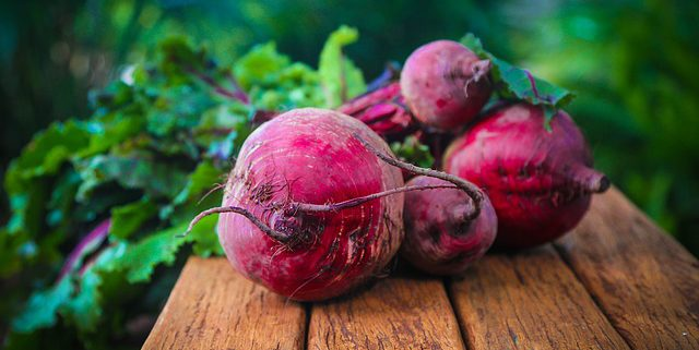 closeup of beets on a brown, wooden table