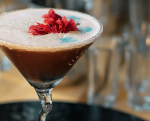 Lychee Chocolate Martini with edible flowers on top