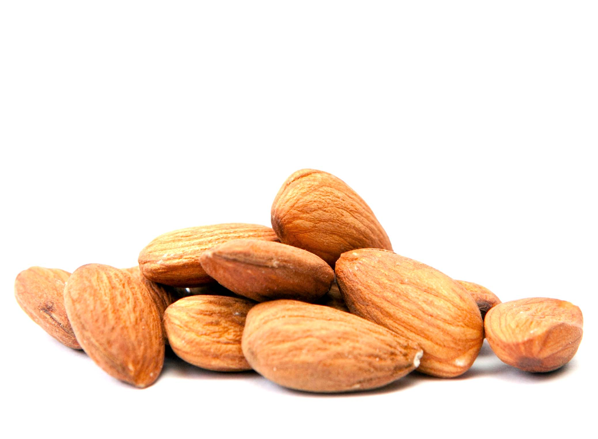 closeup of pile of almonds to help illustrate the benefits of almonds