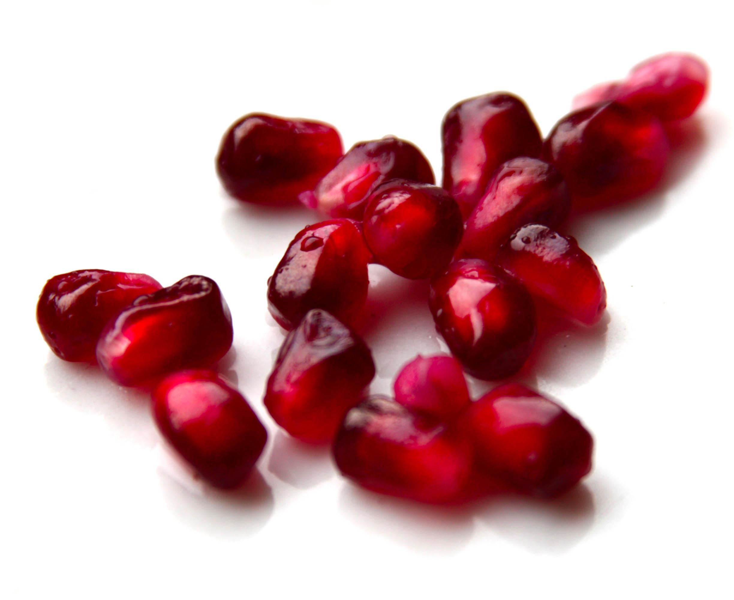 closeup of pomegranate arils to illustrate the benefits of pomegranate
