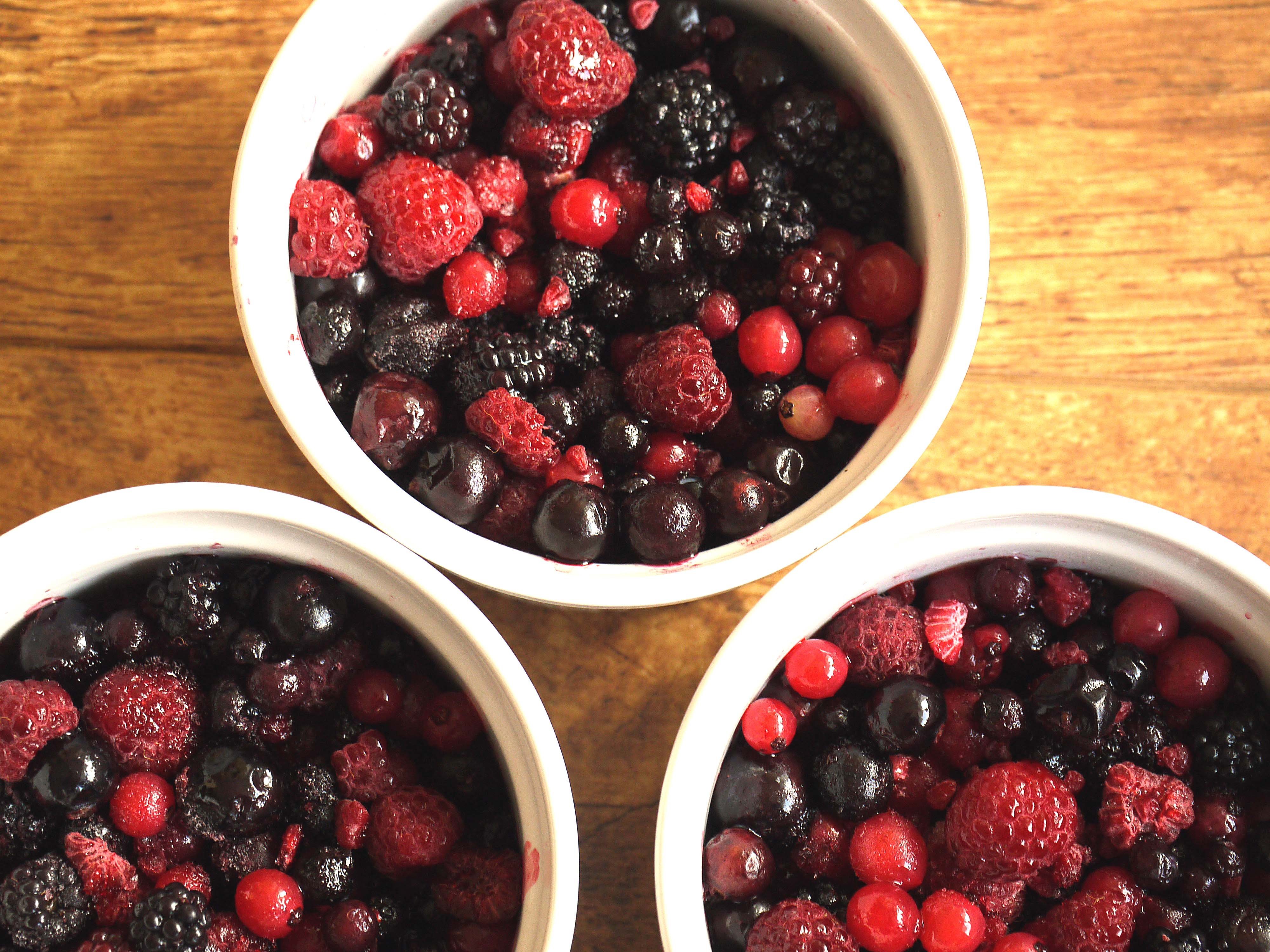 bowls of fresh berries to illustrate reducing refined sugar