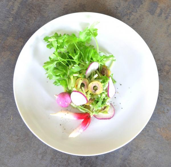 overhead shot of celery olive salad with breakfast radishes