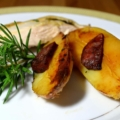 roast chicken breast with chorizo and new potatoes and a sprig of rosemary
