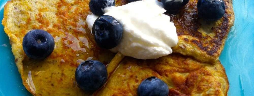 Two Ingredient Banana Pancakes topped with blueberries
