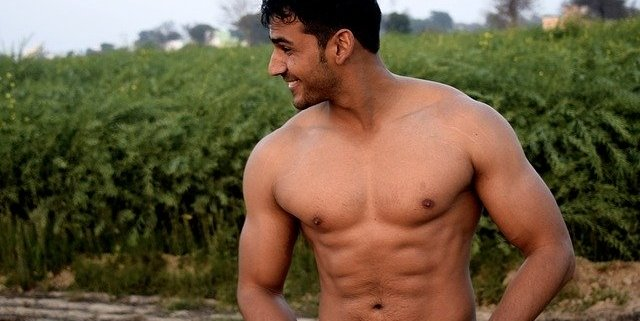 Attractive, smiling shirtless man with 6-pack abs