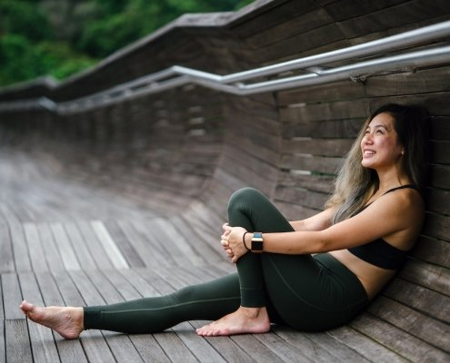 Healthy Woman Sitting on the ground, looking satisfied