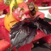 Watermelon and Tomato Salad Closeup on a Black Board