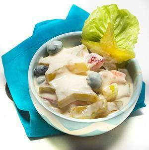 starfruit fruit salad from Brooks Tropicals in a white dish with a turquoise napkin