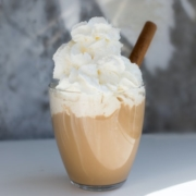 coffee with a kick drink in a glass cup, topped with whipped cream