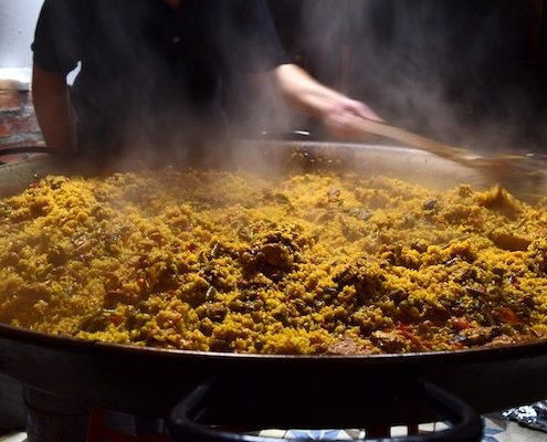 closeup of seafood paella in a traditional pan