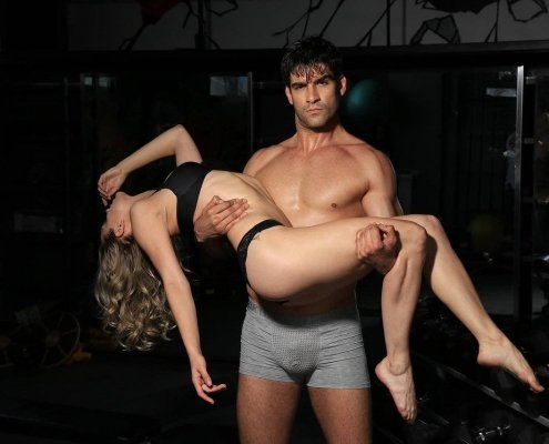 glamorous man holding woman in black underwear to illustrate foods to boost libido in men