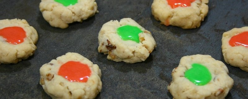 rows of icing cookies with red and green icing