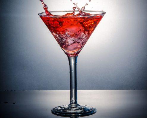 The Aphrodisiac, a pomegranate vodka cocktail in a martini glass