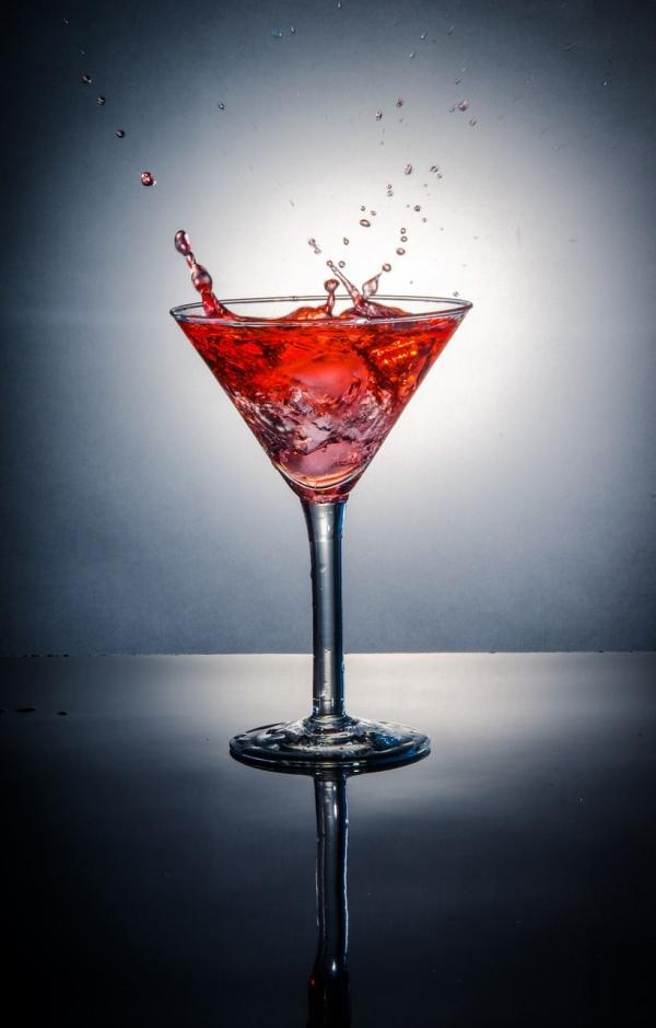The Aphrodisiac, a pomegranate vodka cocktail in a martini glass
