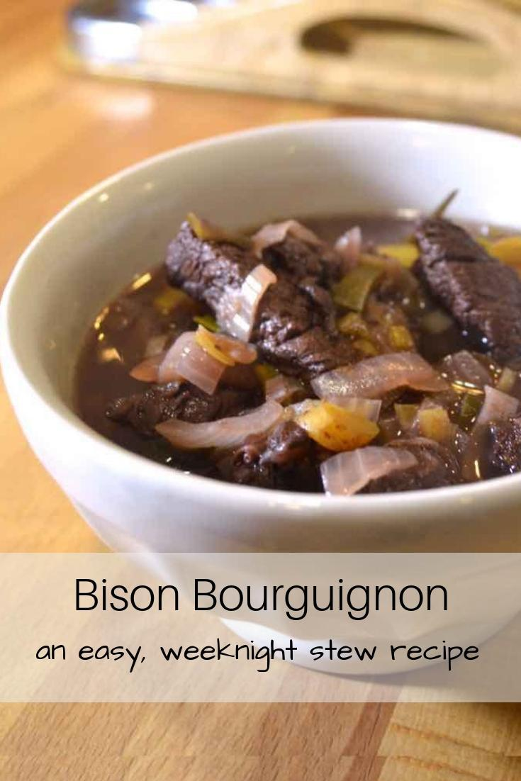 White Bowl with Bison Bourgignon on Cutting Board