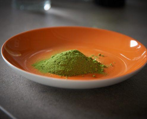Orange bowl with pure moringa powder