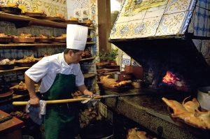 Food is cooked in a traditional oven at the world's oldest restaurant