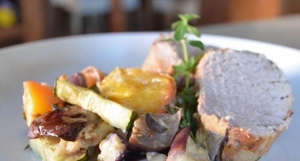 Closeup of Pork Loin with Peach Ratatouille on a blue plate