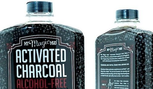 closeup of front and back of My Magic Mud mouthwash bottle