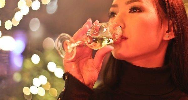 closeup of woman drinking dessert wine