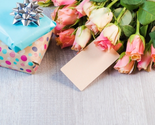Gift Ideas for Mother's Day including flowers, and wrapped presents