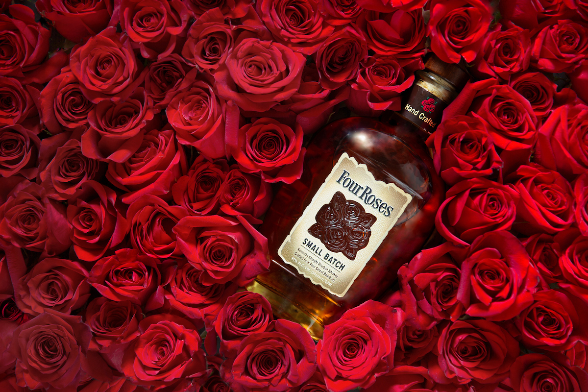 four roses bourbon in a bed of red roses