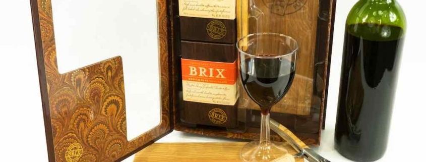 Pairing wine with chocolate gift set from Brix chocolate with a knife, cutting board, chocolates and wine