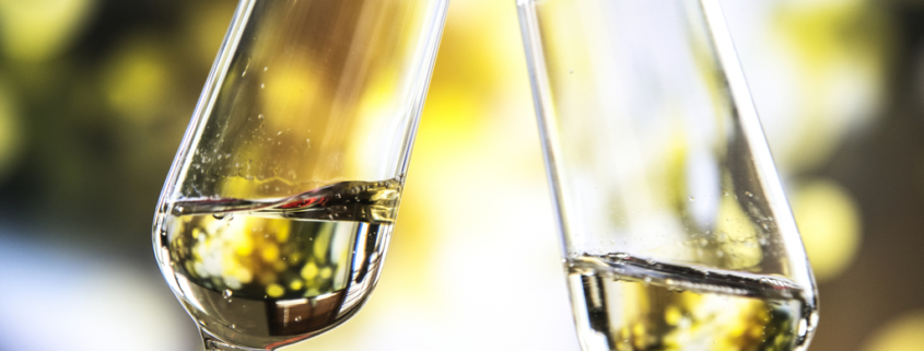 Two flutes of sparkling bubbles about to toast