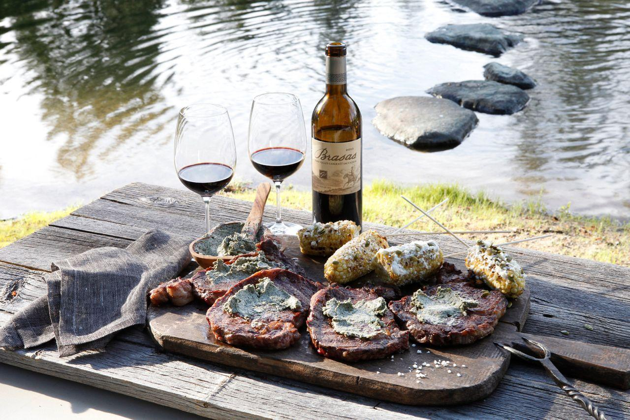 Journeyman Meats Father's Day 2020 special charcuterie on a board with 2 glasses of red wine
