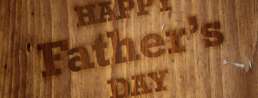 Happy Father's Day written on a brown board