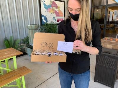Woman holding an ONX wine tasting kit