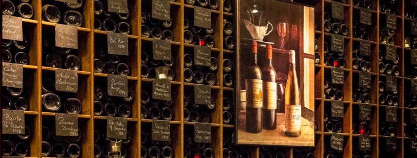 well organized, dimly lit, home wine cellar