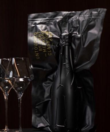 Bottle of Untouched by Light and two Champagne flutes