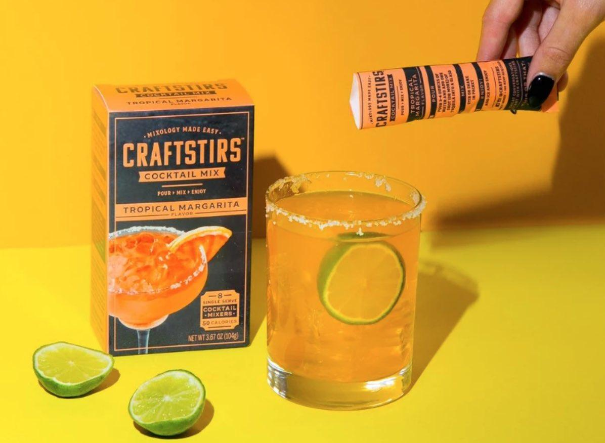 CraftStirs Tropical Margarita in a rocks glass with a box of the product beside it