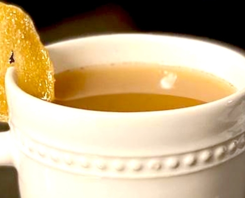 tequila hot toddy cocktail in a white mug