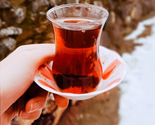 woman's hand holding a sorrel drink in the snow