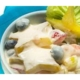 star fruit salad in a bowl with a turquoise napkin