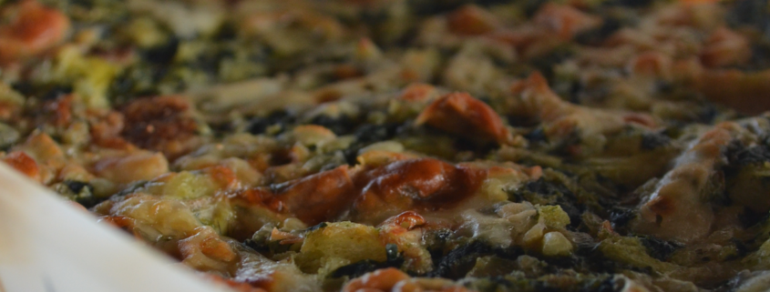 closeup of artichoke, spinach and cheese bread pudding