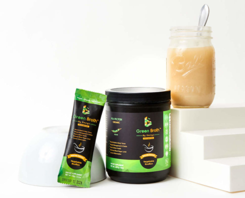 Green Broth By Design vegan bone broth in a packet and canister with a mason jar of broth