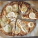 Overhead shot of easy cheese and onion tart on parchment paper