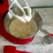 Creme Fraiche Frosting in a red Kitchenaid mixer